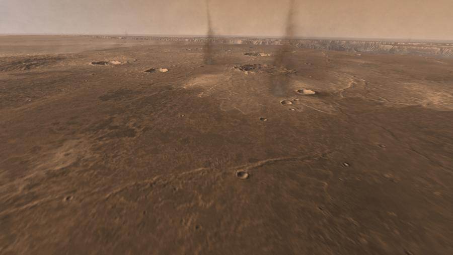 Пылевые вихри на Марсе. Вдали видна долина Маринер.