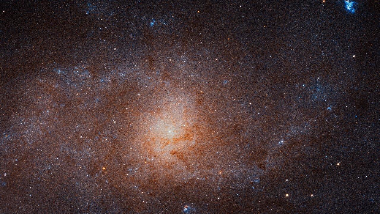 Сильно уменьшенный участок полной фотографии М33, сделанной телескопом Хаббл.